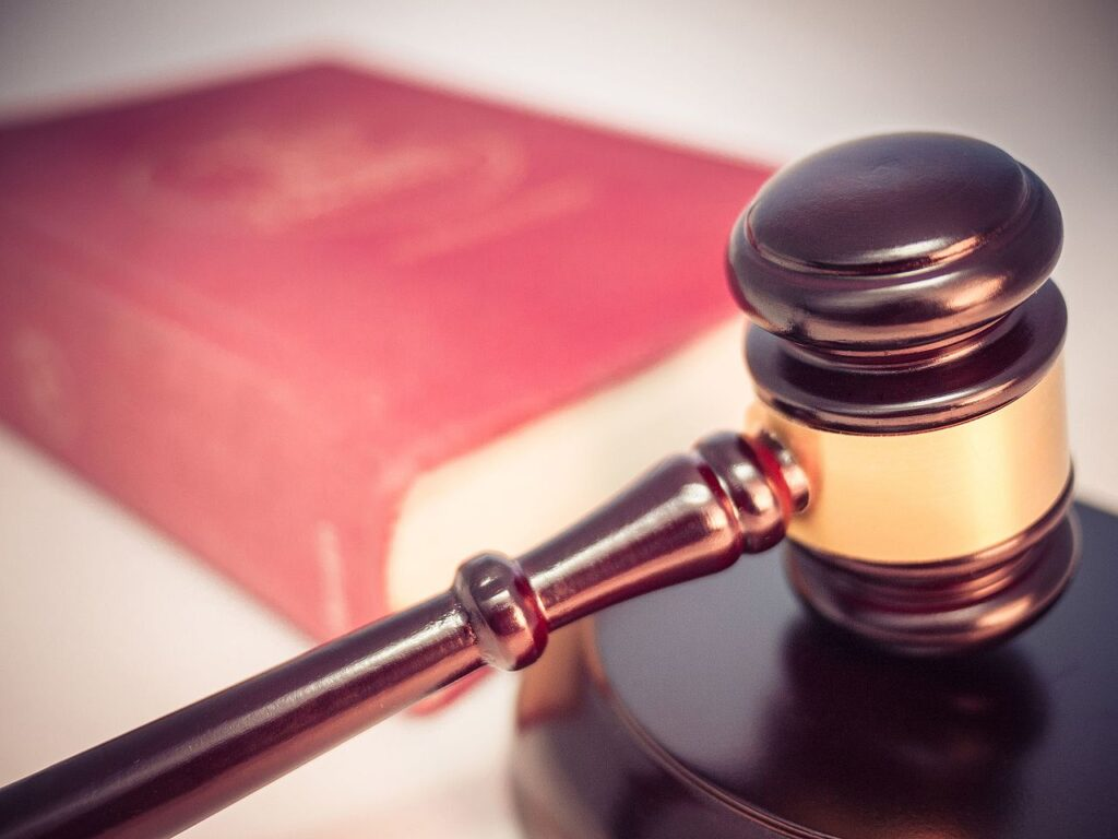 """a law book and a court gavel symbolising the expression """"beyond any reasonable doubt"""""""